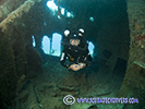 rebreather diver inside the hole on cricket wreck