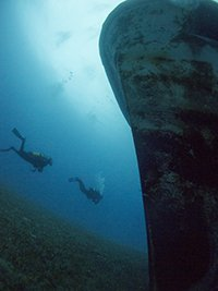 costandis wreck in limassol with divers swimming around the bow