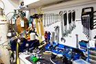 scuba tech cyprus' dive equipment servicing bench with servicing tools and kits