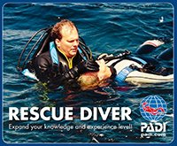 Diving Instructor gives simulated rescue breaths to a diving victim