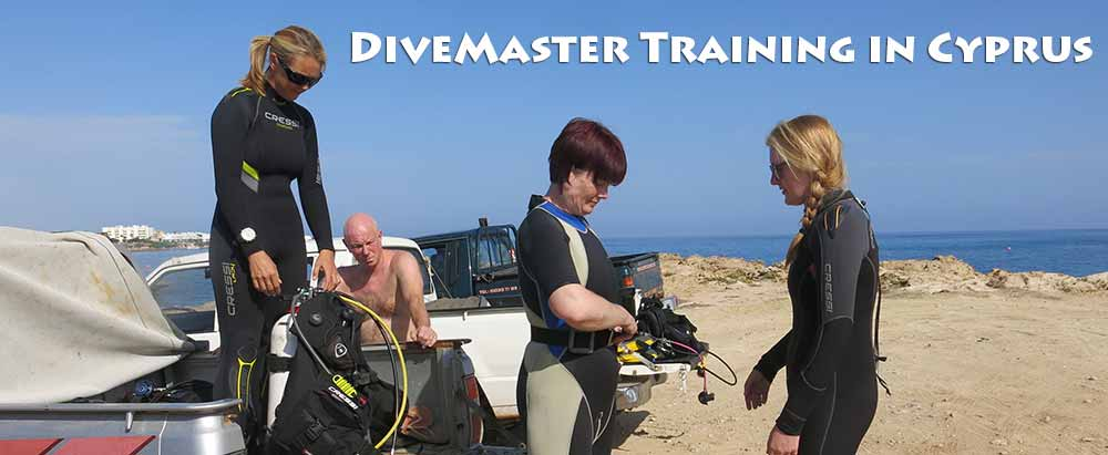 Divemaster assists instructor for a discover scuba diving experience