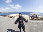 diver wears a drysuit for the winter diving in Cyprus. Goes well with the sunglasses