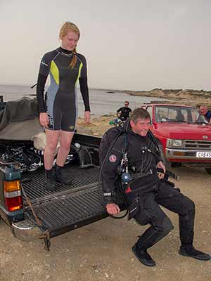 rich walker the gue fundamentals instructor gets kitted up by Scuba Tech divemaster, lucy