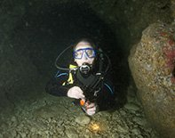 scuba diving in cyprus. Diver in a cave