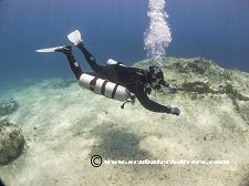 Diver with sidemount configuration using the Razor Sidemount System