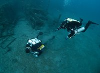 Technical divers performing skills at 42m on the seabed next to Zenobia Shipwreck in Larnaca Cyprus