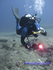 diver with underwater video camera
